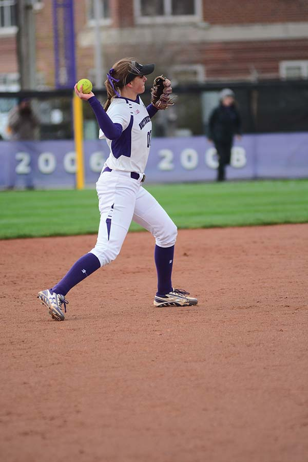 Andrea Filler throws the ball to first base. The senior shortstop paced the Cats' offense over the weekend, hitting to a .563 batting average.