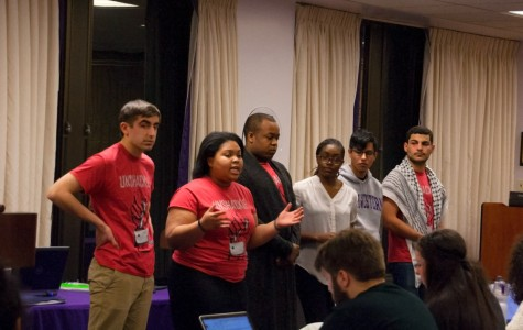 Members of Unshackle NU present legislation Wednesday night at Associated Student Government Senate that would call on the University to divest from corporations they say benefit from the mass incarceration of people of color. The resolution, which will be voted on next week, was sponsored by 21 student groups.