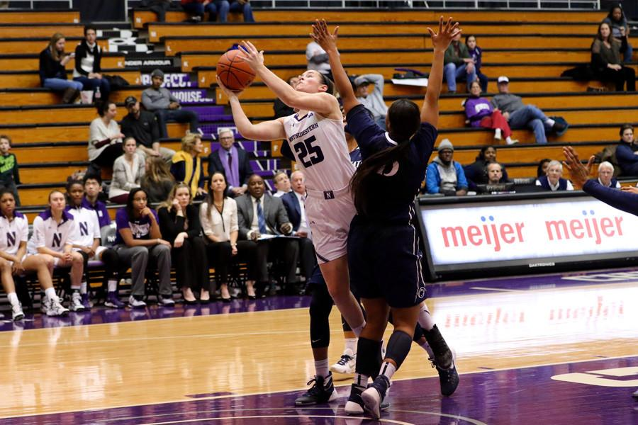 Maggie Lyon fights through the defense. The senior guard led Northwestern with 5 turnovers Wednesday night.