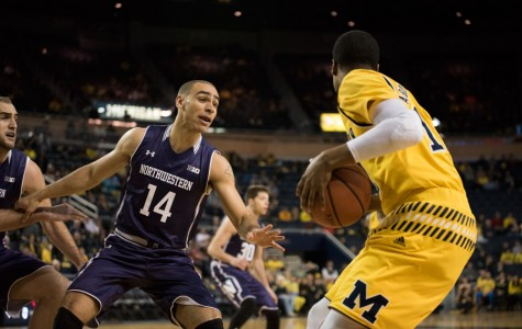 Tre Demps tries to keep up with a Michigan player. The senior guard was the only Wildcat to make all of his free throws Wednesday, going 2-for-2 from the line.