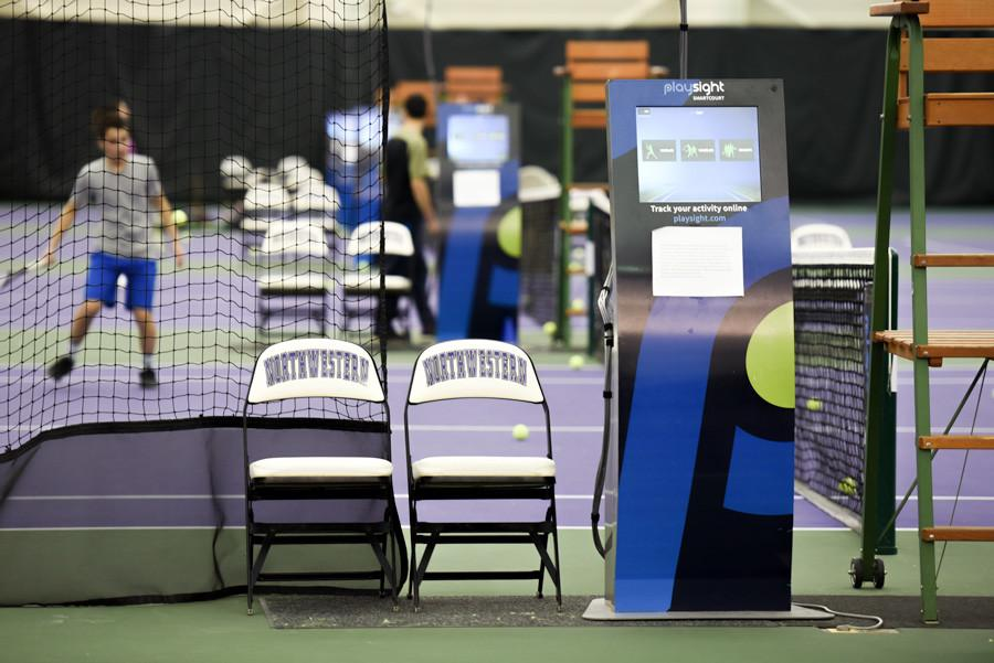 A PlaySight kiosk sits beside a tennis court. The data collection system has greatly benefitted the men's and women's tennis teams so far this season.