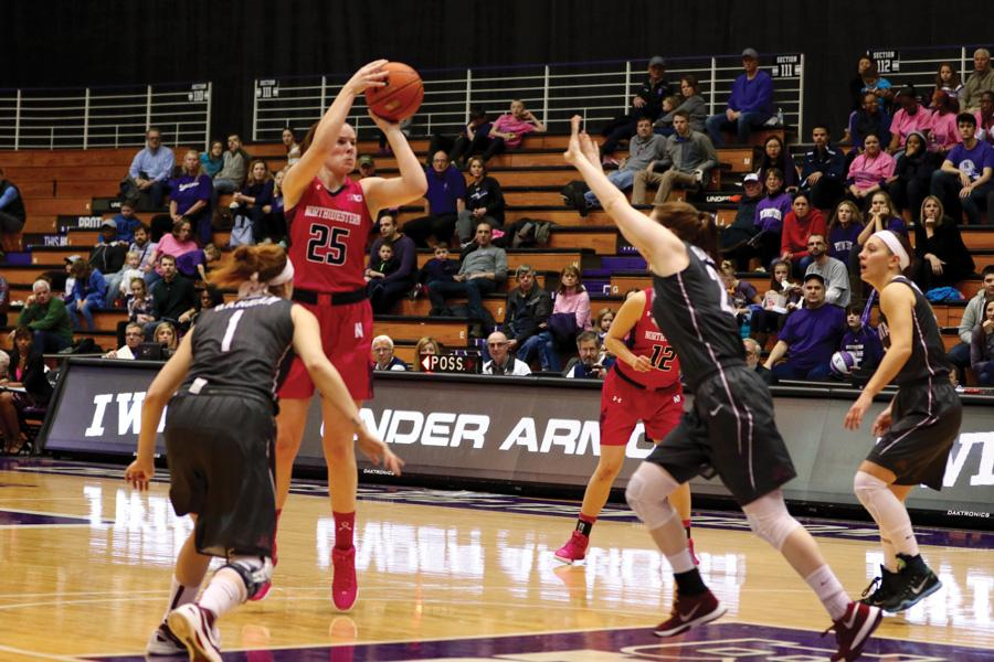 Maggie Lyon pulls up for a shot. The senior guard notched a double-double in Sunday's loss to Minnesota with 31 points and 12 rebounds.
