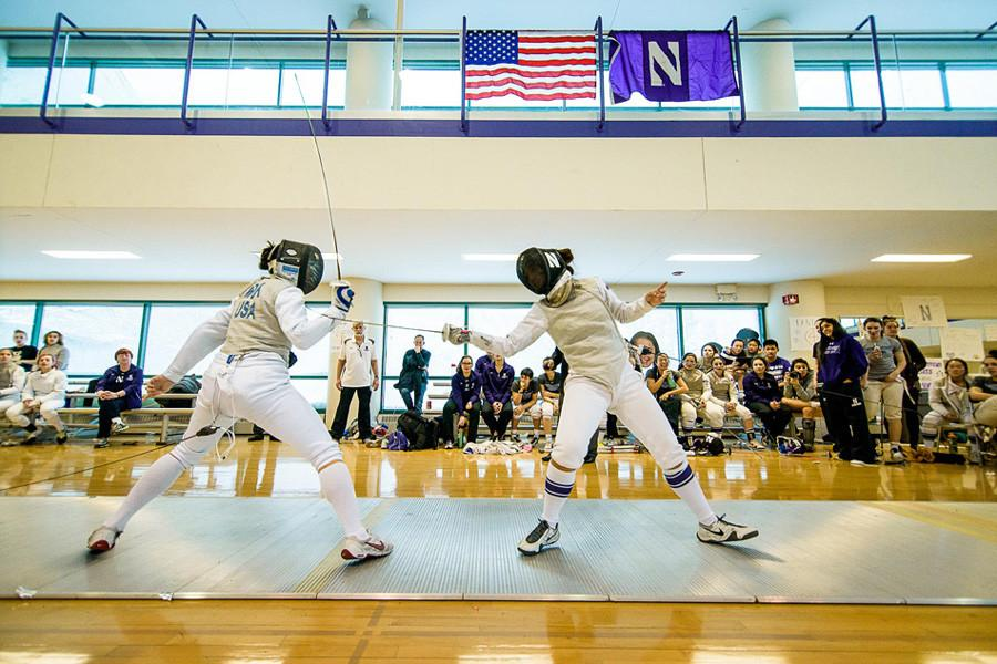 Stella Pointeau (right) fences with an opponent. The junior foil has only lost one match in her entire career.