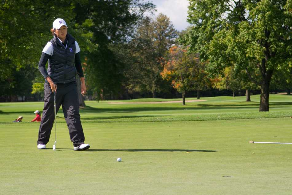 Sarah Cho walks to her ball on the putting green. The sophomore won the Big Ten Championship last spring.
