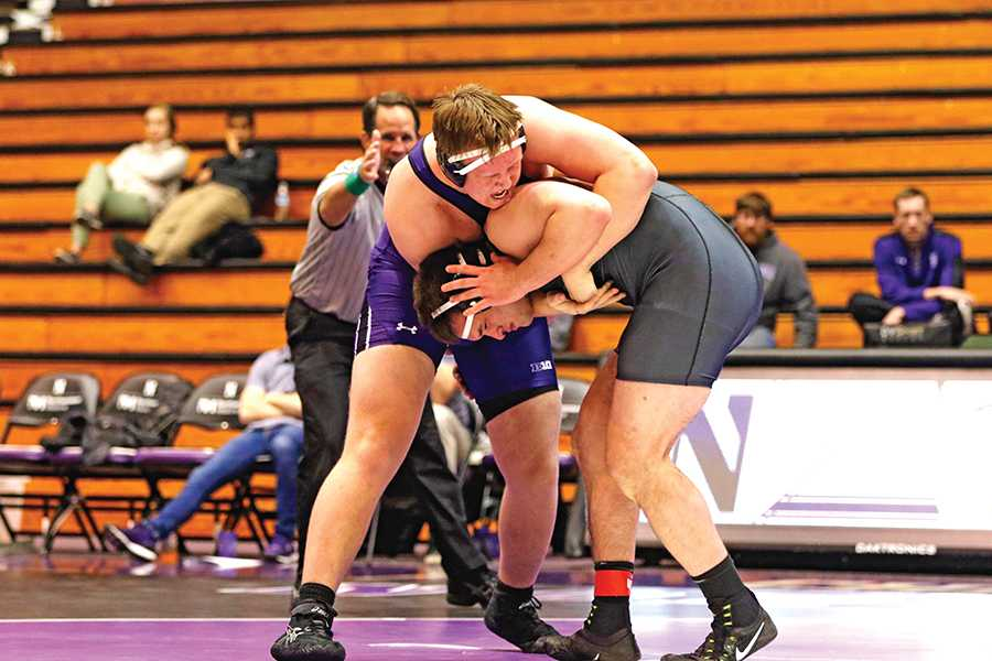 Conan Jennings wraps up an opponent. The redshirt freshman pulled out a last-second victory in the final match of Friday night's dual with Duke, giving Northwestern it's second victory of the season on Senior Night.