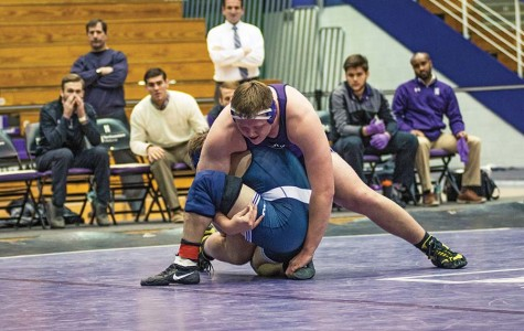 Wrestling: Oster's pin not enough for struggling Wildcats