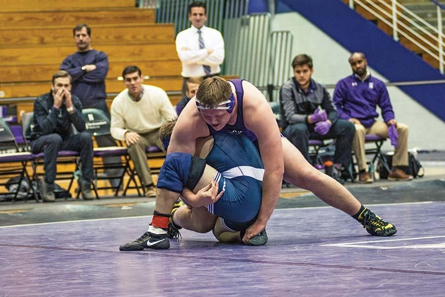 Conan Jennings towers over his opponent. The freshman 285-pounder lost the last bout in the Wildcats' match with Nebraska 8-4.