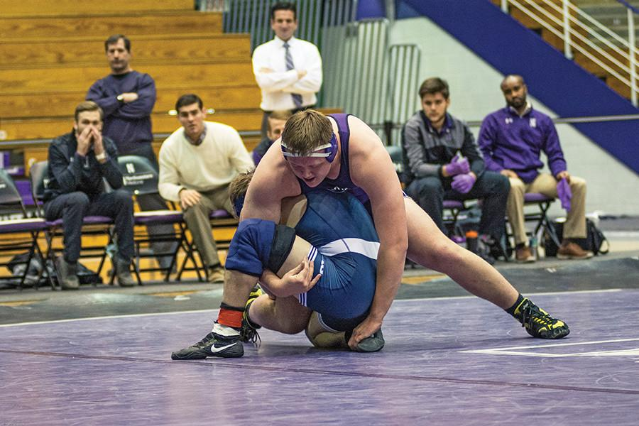 Conan Jennings wrestles with an opponent. The redshirt freshman lost his last bout against Michigan State last weekend.