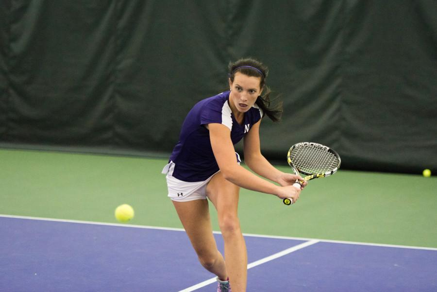 Jillian Rooney sets up for a return shot. The junior won her No. 6 singles match after a third-set tiebreak victory.