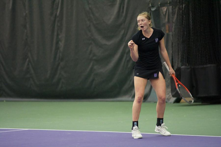 Alicia Barnett pumps her fist. The senior won both of her matches last weekend against Duke and is looking to carry over her success this Sunday.