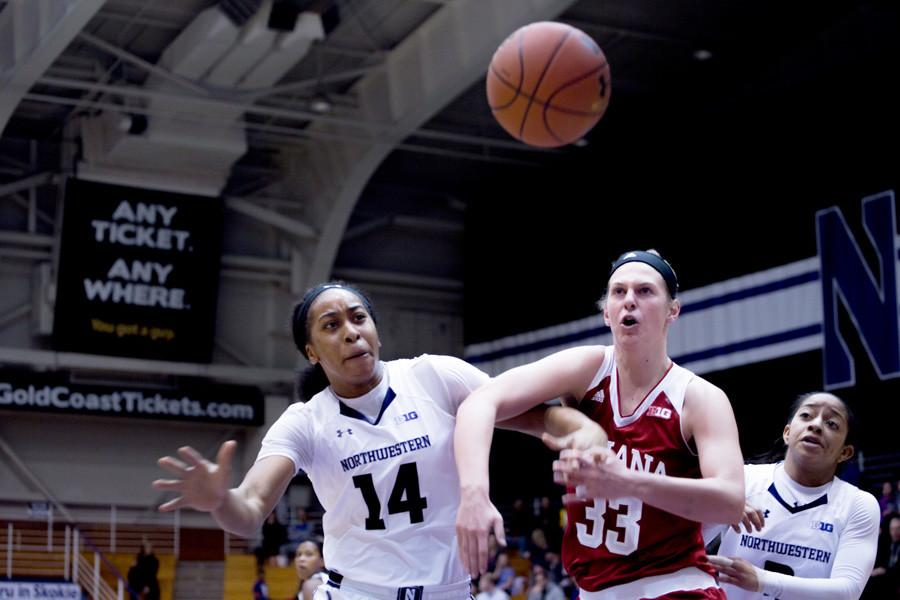 Pallas+Kunaiyi-Akpanah+fights+with+a+defender+for+the+ball.+The+freshman+tied+her+career-high+in+rebounds+against+Minnesota+with+16.