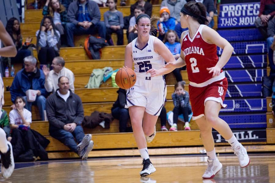 Maggie Lyon dribbles up the court. The senior will be playing her final regular season game at Welsh-Ryan Arena on Tuesday night.