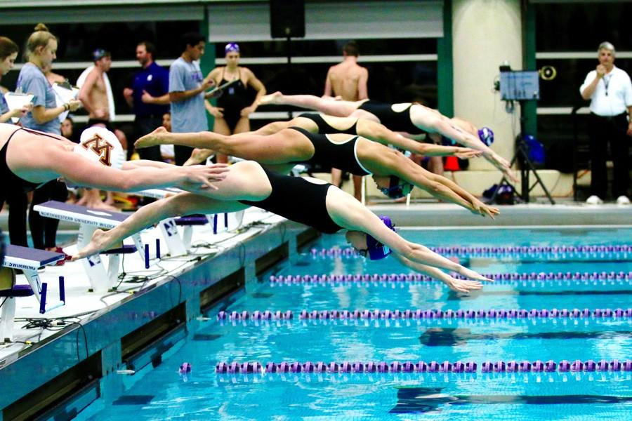 Northwestern+swimmers+launch+from+the+starting+blocks.+Only+one+Wildcat%2C+freshman+Olivia+Rosendahl%2C+was+named+an+all-Big+Ten+selection+this+season.+