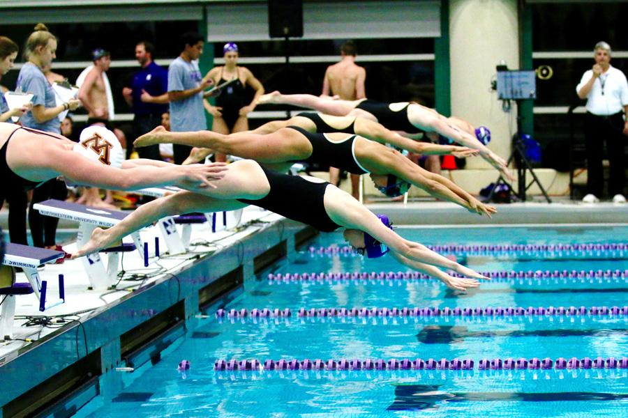 northwestern swimmers launch from the starting blocks only one wildcat freshman olivia rosendahl