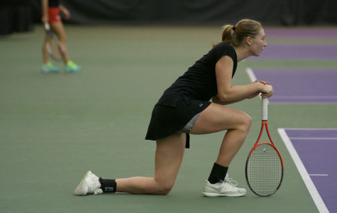 Alicia Barnett kneels in between points. The senior dropped both her matches to UCLA on Sunday.