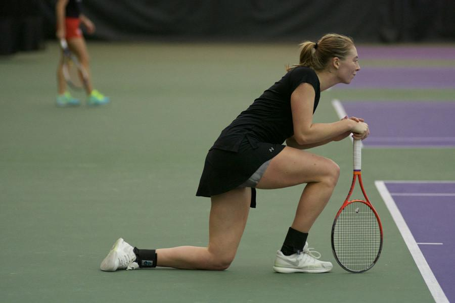 Alicia+Barnett+kneels+in+between+points.+The+senior+dropped+both+her+matches+to+UCLA+on+Sunday.+