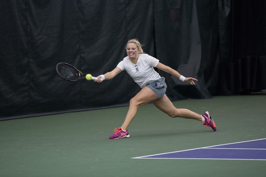 Alex+Chatt+lunges+for+the+ball.+The+sophomore+fell+in+her+doubles+match+against+Alabama%2C+but+won+in+singles.