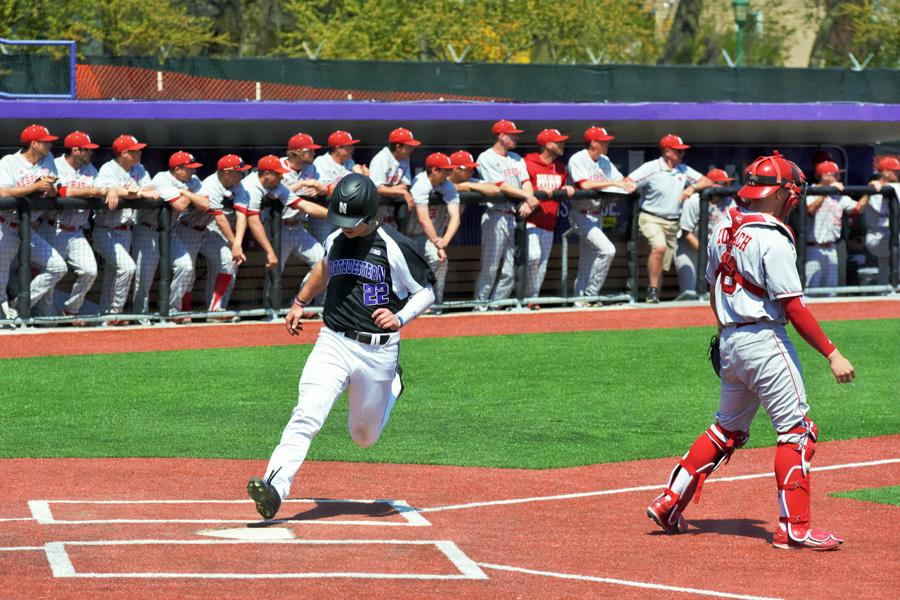 RJ Watters crosses the plate for a run. The junior outfielder made the most of his starts over spring break, including a diving catch at the warning track Sunday.