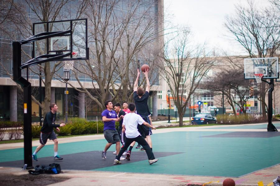 Students play basketball outside Bobb Hall, where the courts were recently updated.  The courts outside McCulloch Hall and Foster-Walker Complex were also given an upgrade.