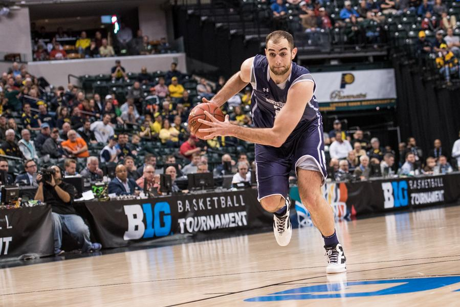 Alex+Olah+drives+down+the+court.+The+senior+center+gave+an+emotional+postgame+press+conference%2C+and+teared+up+at+one+point%2C+after+perhaps+his+final+game+as+a+Wildcat.+
