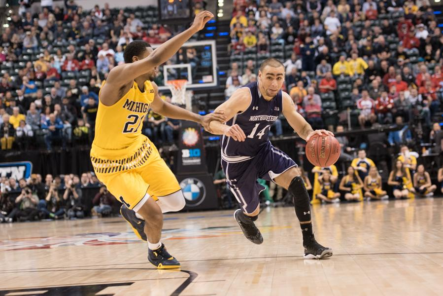 Tre+Demps+muscles+his+way+past+a+defender.+The+senior+guard%27s+2015-16+season+was+filled+with+ups+and+downs%2C+but+his+21+points+Thursday+against+Michigan+helped+keep+Northwestern+in+the+game.+