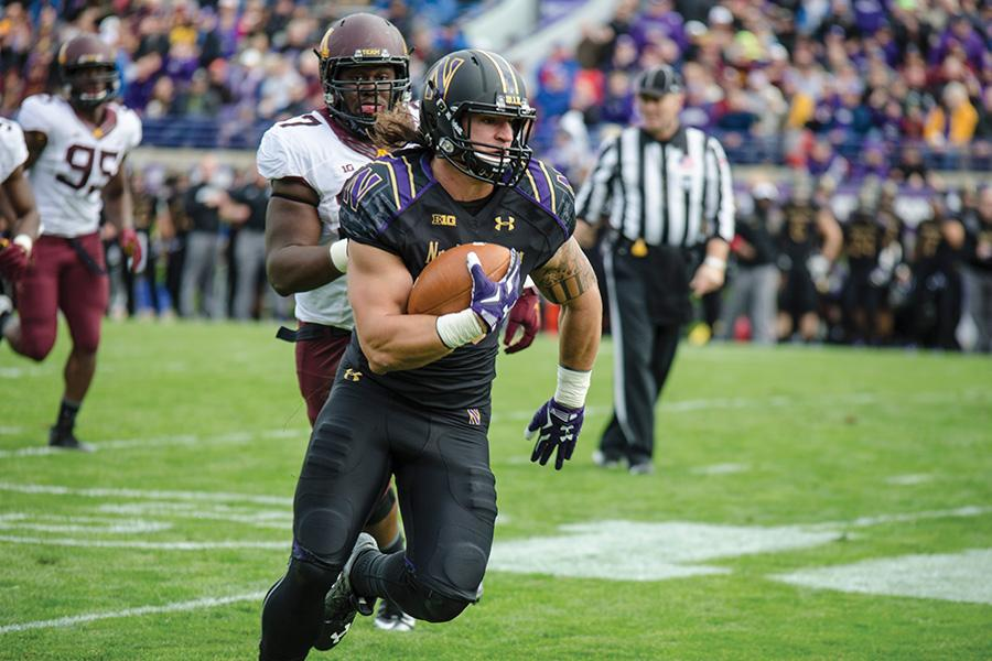 Dan Vitale turns upfield. The former Northwestern superback boosted his draft stock as one of the top performers in various athletic drills during the weekend's NFL Draft Combine.