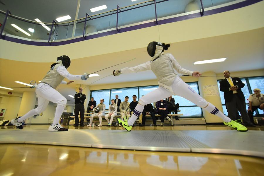 A Northwestern fencer lunges toward her opponent. The Wildcats won the Midwest Conference Championship this weekend, the fourth such title of coach Laurie Schiller's career.