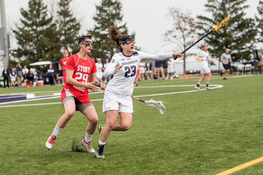 Lauren+Murray+catches+a+pass+from+her+teammate.+The+senior+midfielder+has+been+essential+to+Northwestern%E2%80%99s+defense+this+season.+