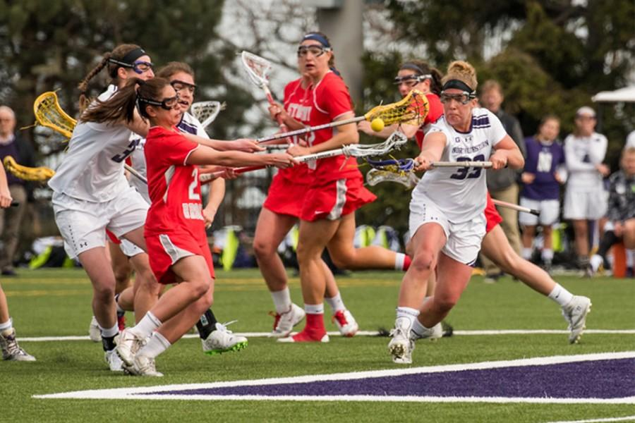 Shelby+Fredericks+fights+with+an+opposing+player+for+the+ball.+The+sophomore+scored+four+goals+over+Northwestern%E2%80%99s+last+two+games.