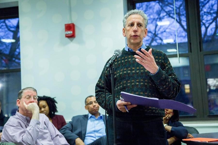 Provost Dan Linzer speaks to students and fellow administrators at Sargent dining hall on Wednesday. A crowd of 50 that included students and mostly faculty and administrators gathered to discuss Northwestern's ongoing efforts to make the University's academic system more inclusive.