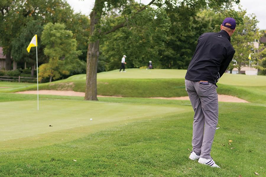 A Northwestern golfer chips the ball onto the green. The Wildcats dug a huge early hole by shooting a combined 16-over in the first round of the Southwestern Jones Invitational and weren't able to recover.