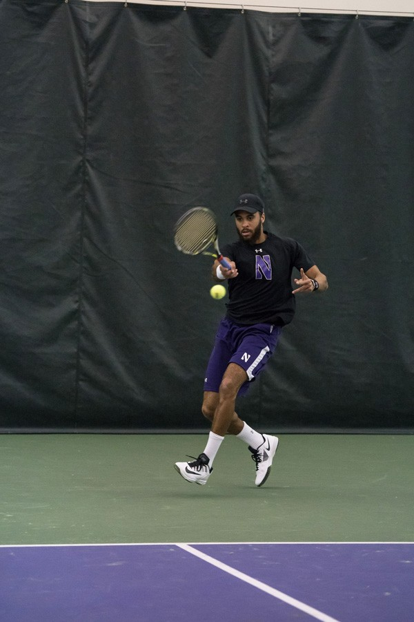 Sam Shropshire takes a forehand stroke at the ball. The junior has been mainly partnered with fellow junior Konrad Zieba in Northwestern's critical doubles matches.