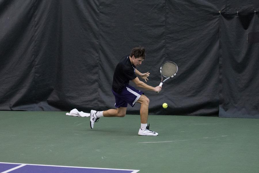 Alp Horoz prepares a backhand stroke. The junior helped lock down Sunday's doubleheader, winning both of his singles matches.