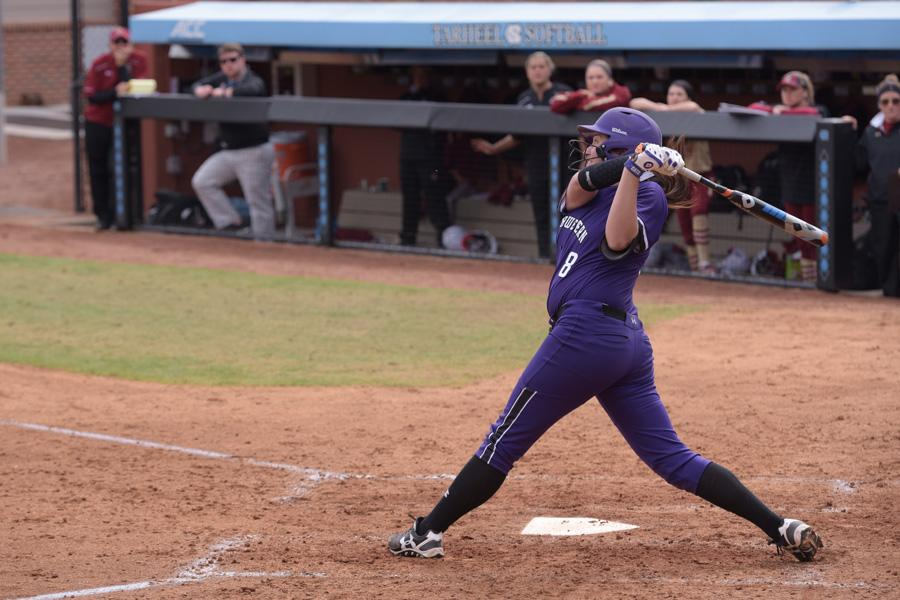 Amy Letourneau takes a swing. The senior pitcher tied a school record Friday, hitting eight RBIs in a victory over New Mexico State.