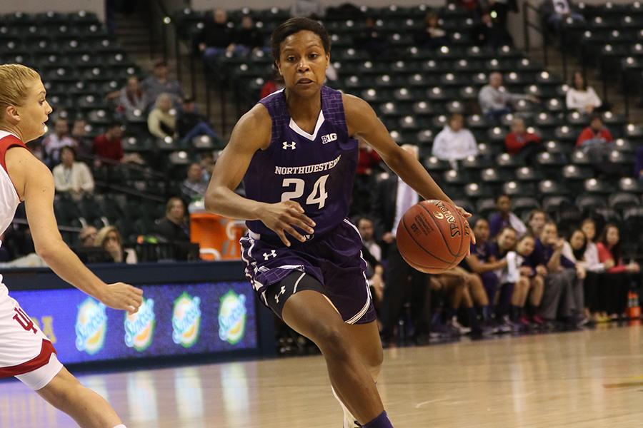 Christen Inman dribbles around a defender. The junior guard scored 14 of her 18 points in the fourth quarter, helping NU clinch the quarterfinal game against Indiana.