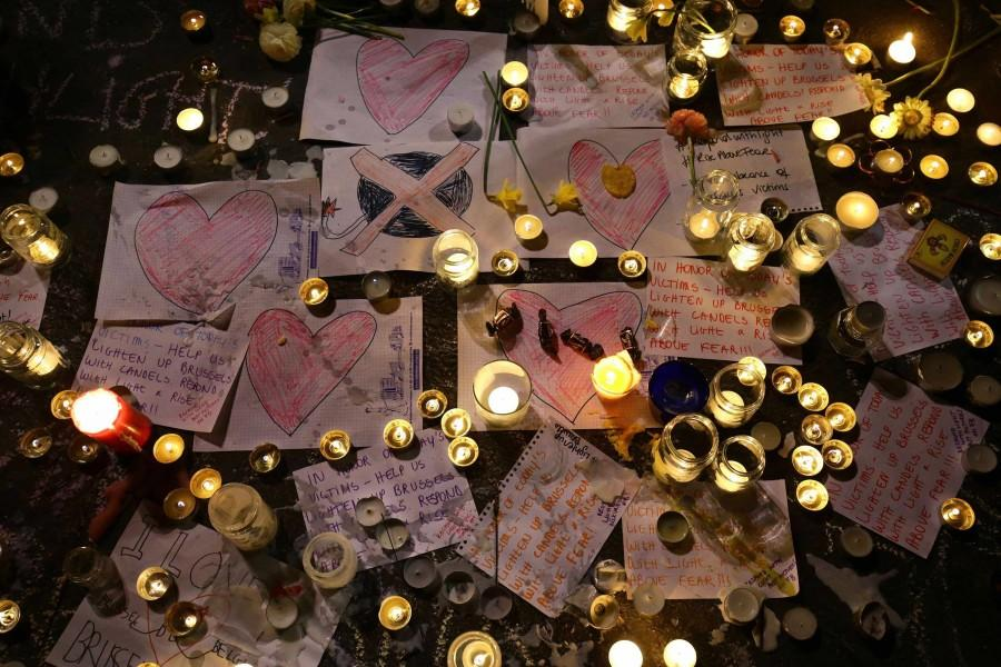 Messages and tributes placed by members of the public following the terrorist attacks in Brussels on March 22. One Northwestern student interning in Brussels checked in safe shortly after the attacks.