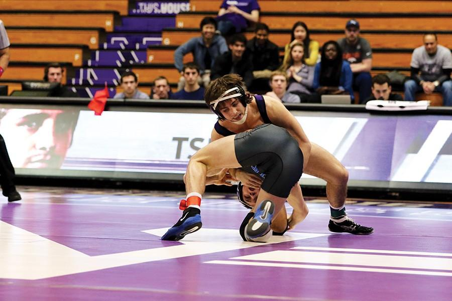 Jason+Tsirtsis+grapples+with+his+opponent.+The+junior+received+the+No.+4+seed+in+his+weight+class+heading+into+the+Big+Ten+championships.+