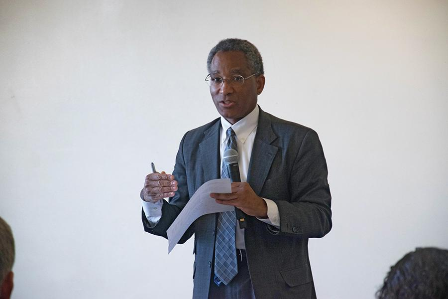 Philip Harris, Northwestern's vice president and general counsel, talks about the naming of spaces on campus during the third community dialogue held in Norris University Center. The event was part of a four-part series of discussions aimed at making NU a more inclusive community.