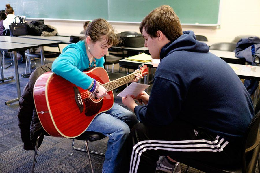 Students and participants in Northwestern's AMASE program practice the guitar. The group gathers on Saturdays to foster a shared passion for music and art.
