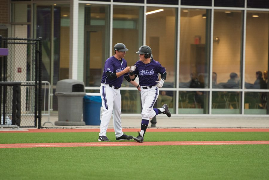 Willie Bourbon rounds third base after hitting a home run. The freshman leads Northwestern in RBIs with 21.
