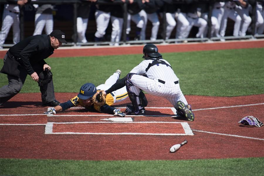 Jack+Claeys+tags+a+Michigan+runner+out+at+the+plate.+The+sophomore+catcher+scored+2+of+Northwestern%E2%80%99s+9+runs+in+Sunday%E2%80%99s+loss.+
