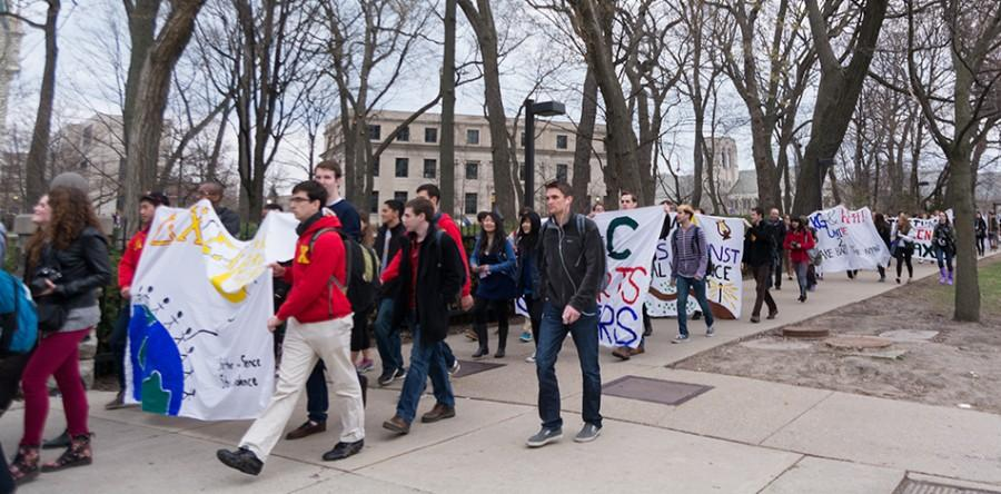 Students march near Norris University Center to show support for survivors of sexual violence during Take Back the Night March. The march will take place again this year as part of programming by students in observance of Sexual Assault Awareness and Prevention Month.
