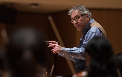 Director of orchestras conducts with connection to memory, emotion