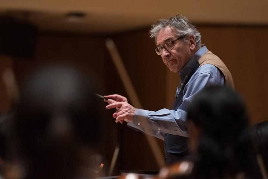 Bienen Prof. Victor Yampolsky conducts the Northwestern University Symphony Orchestra in preparation for its April 23 performance in Pick-Staiger Concert Hall. Yampolsky has been the director of orchestras since 1984.