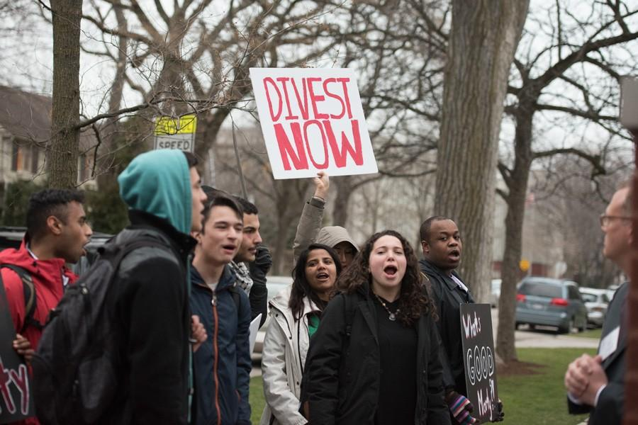 Student+activists+gather+outside+University+President+Morton+Schapiro%27s+house.+While+protesters+marched+to+Schapiro%27s+Orrington+house%2C+Schapiro+was+holding+a+dinner+for+students%2C+including+ASG+members.++