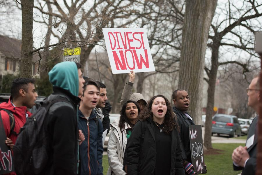 Student activists gather outside University President Morton Schapiro's house. While protesters marched to Schapiro's Orrington house, Schapiro was holding a dinner for students, including ASG members.