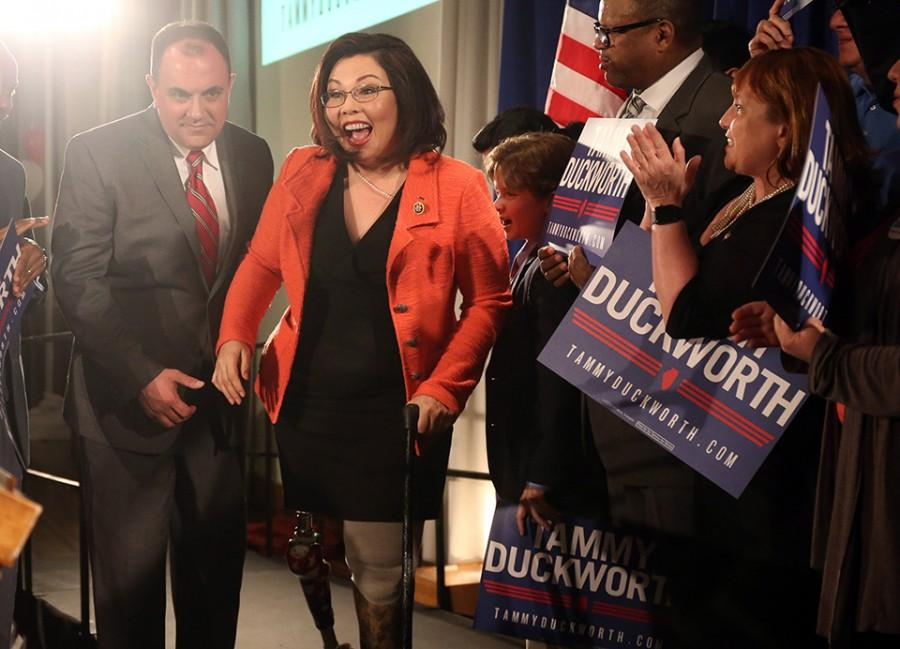U.S.+Rep.+Tammy+Duckworth+celebrates+on+March+15+after+her+Democratic+primary+victory+on+election+night+at+the+Ivy+Room+in+Chicago.+She+was+endorsed+by+President+Barack+Obama+in+her+Senate+race+against+Mark+Kirk+on+Wednesday.