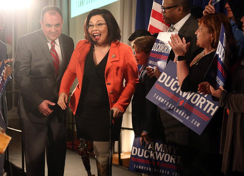 U.S. Rep. Tammy Duckworth celebrates on March 15 after her Democratic primary victory on election night at the Ivy Room in Chicago. She was endorsed by President Barack Obama in her Senate race against Mark Kirk on Wednesday.