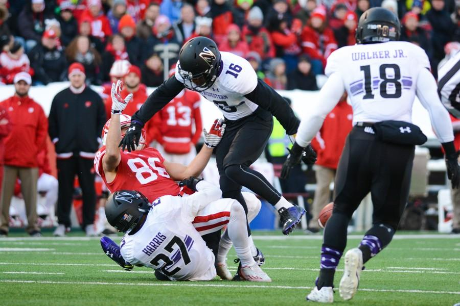 Matthew Harris and Godwin Igwebuike break up a pass. As the only returning starters in Northwestern's secondary, the two are expected to take on larger leadership roles next season.