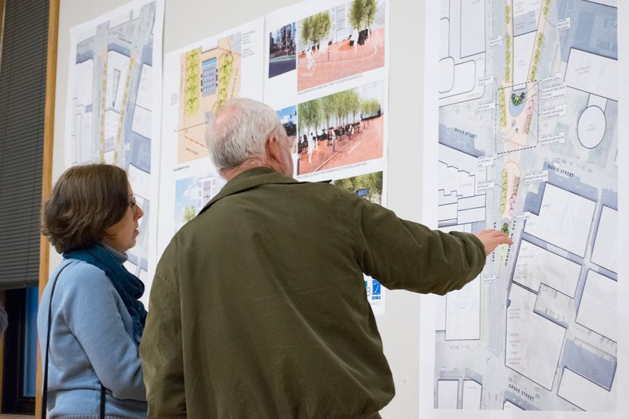 Evanston+residents+look+at+preliminary+plans+for+the+Fountain+Square+Plaza%2C+which+are+displayed+on+posters+around+the+room.+Community+members+and+city+staff+discussed+how+to+make+a+veteran%E2%80%99s+memorial+the+focal+point+of+the+square+at+the+meeting+Thursday+evening.+